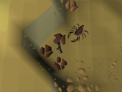 This image depicts a method of safespotting the scorpions in the Al Kharid mine.